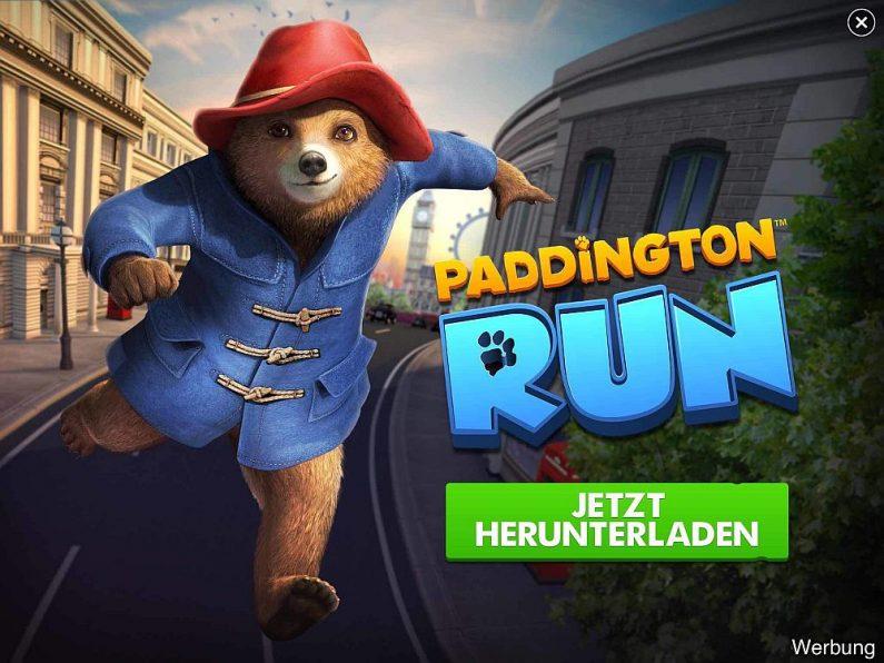 Werbung für das rechtzeitig vor Filmstart erschienene Mobile Game Paddington Run - als Banner, das den gesamten Bildschirm bedeckt. (Screenshot aus Gameloft Spiel Ciry Mania)